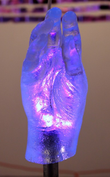 MILAGROS I [detail], 2012, 48x17x17, resin cast of surgically reconstructed hand, metal pipe, silicone, caulk, wood, paint, black light