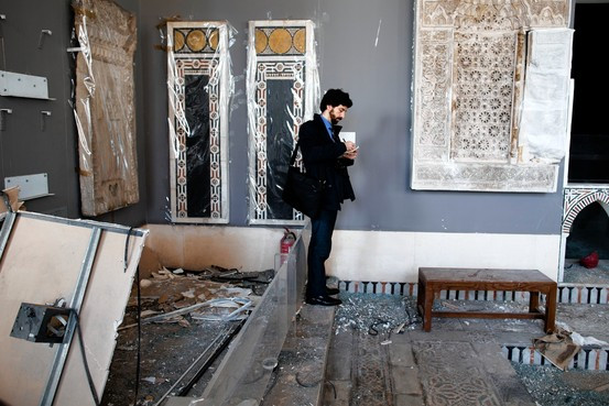 A Unesco member records the damage at Cairo's Museum of Islamic Art, which was recently bombed. Associated Press