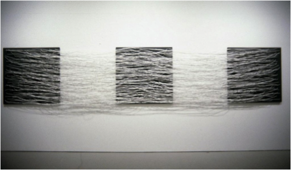 Installation view of Eva Hesse, Metronomic Irregularity II, 1966. Painted wood and cotton-covered wire, 48 x 240 inches. Whereabouts unknown since 1971