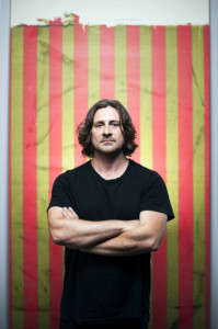 KARSTEN MORAN   THE NEW YORK TIMES Artist Wade Guyton in his New York studio in front of a work produced by an inkjet printer on linen