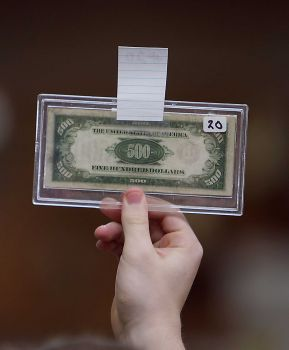 A $500 bill being auctioned off from Michael Brown's estate auction in January as part of his bankruptcy trial.