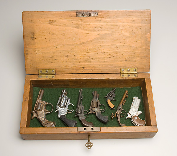 Collection of Guns in a Box