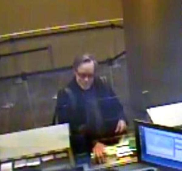 Joseph Gibbons robs a bank as an artwork. Photo NYPD.