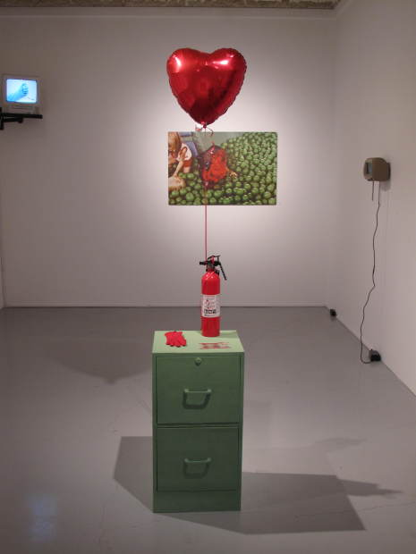 Installation view with Archival Science, 2014. flocked filing cabinet, grandmother's glove, 1984 coins, balloon, fire extinguisher.