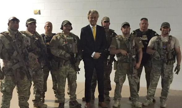 Wilders poses with Garland security. AP photo.