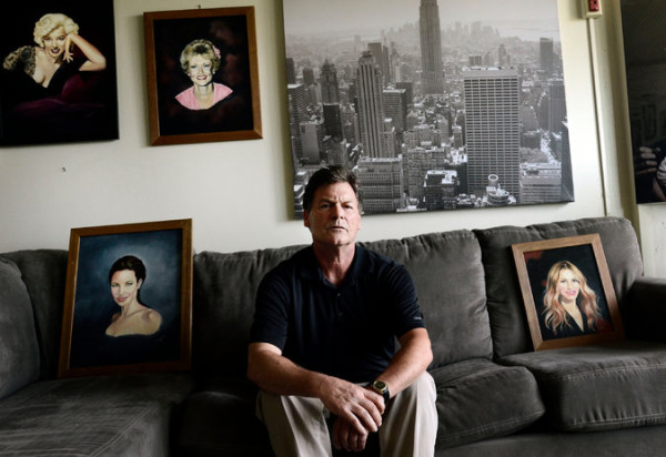 John Mulligan, who served two and a half years in prison with Richard W. Matt, with some of Matt's paintings. Photo by Heather Ainsworth via The New York Times.