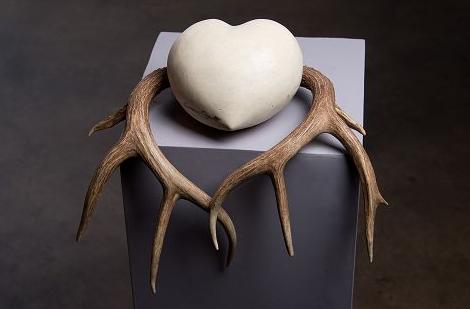 Sabine Senft, #7 Rooted, 2014. Handcarved limestone, antlers, gold leaf.