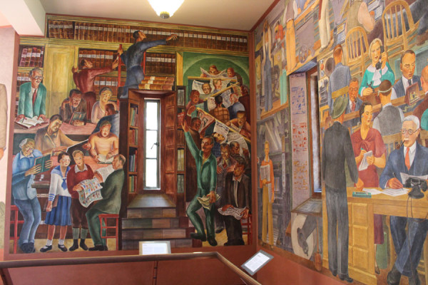Installation view of the legendary Coit Tower murals in San Francisco, a WPA project