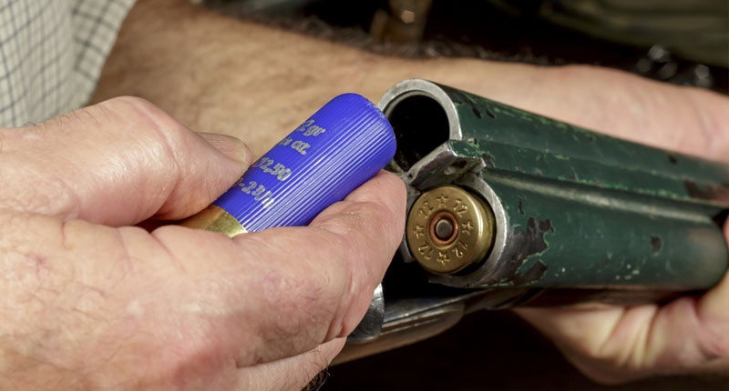 a-man-loading-a-shotgun-shutterstock-800x430