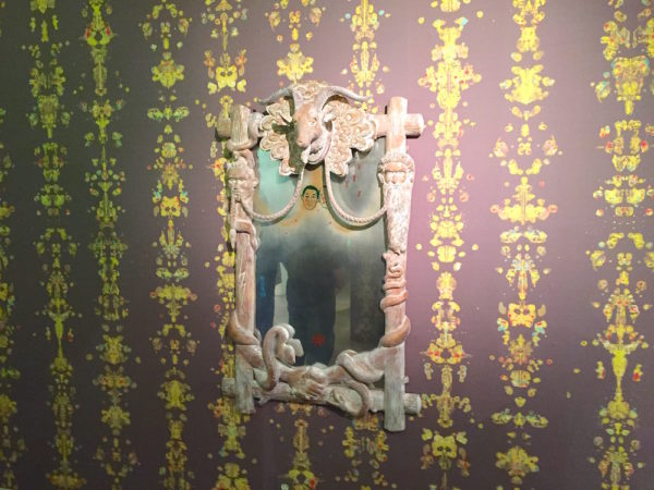 """Heyd Fontenot, installation view of """"Kult Klassic"""", custom wallpaper with painted and mirrored glass in hand-carved frame, 2016."""