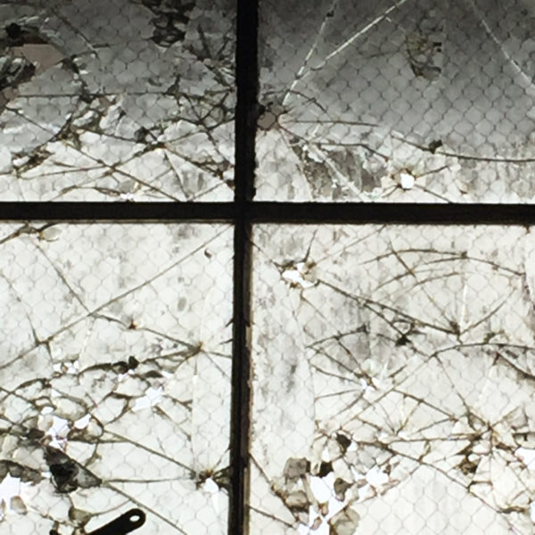 Box Company bullet-holed windows