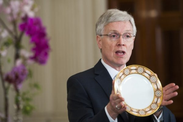 White House Curator William Allman holds a historic plate in the State Dining Room in 2015. (Katherine Frey/The Washington Post)