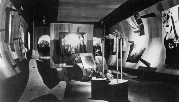 Frederick Keisler seated in the foreground of Peggy Guggenheim's gallery, Art of This Century, 1942