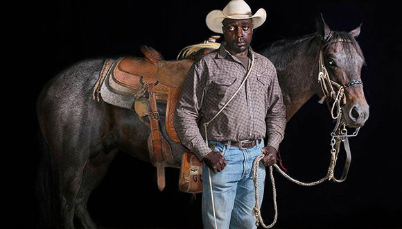 Photograph of a cowboy with a horse from Cowboys of Color by Don Russell