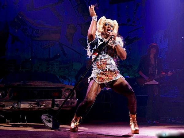 Taye Diggs as Hedwig in a production of Hedwig and the Angry Inch. Hedwig has also been played by Andrew Rannells, Neil Patrick Harris, Michael C. Hall, Ally Sheedy, Lena Hall, and of course John Cameron Mitchell, among others.