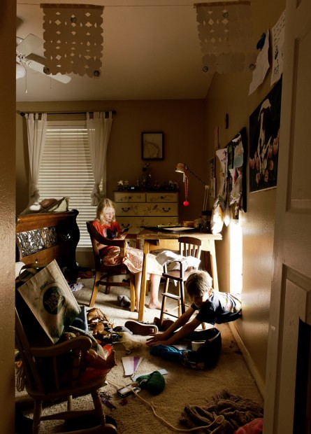 """Madeleine sits in her room, which was the set of the video, """"Whole"""" where we cut holes into the walls and doors of our home with hammers and saws and then climbed through them from room to room.  The video is finished, but the holes in the walls are still there."""
