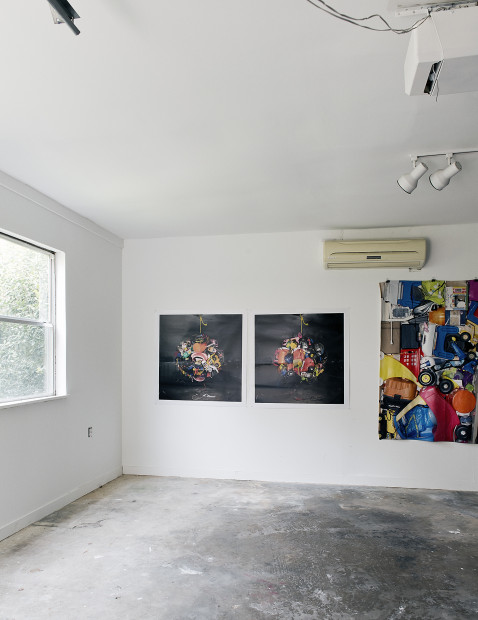 """This is a view of the interior of our garage with a photograph of a 6' in diameter ball of stuff.  These photographs were printed on polar fleece blankets as part of the """"Comfort"""" series."""