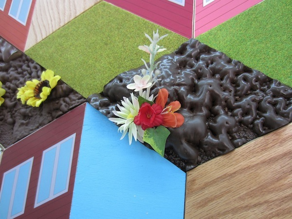 """Variable Landscape, detail, plywood, paint, foam, stain, plastic plants, mounted giclee prints, 110"""" x 192"""", 2013"""
