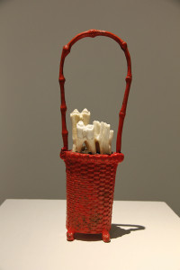 Basket, 2012, found object, concrete filler, bovine and humanteeth, 10 ½ x 5 x 2 inches