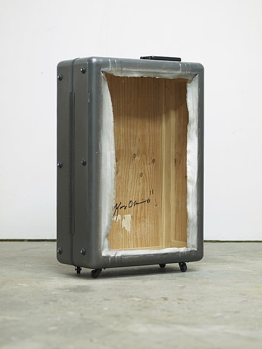 "Kaz Oshiro, ""Zero Zero Case Spinner (Gun Metal-torn FRAGILE stickers), 2011, acrylic, Bondo on stretched canvas, caster wheels"
