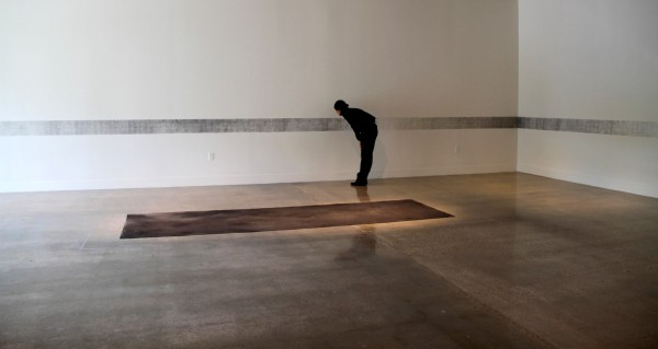 Memento, site-spefific installation, 2012, victims' names transferred on wall, ashes from burned paper list, dimensions vary.