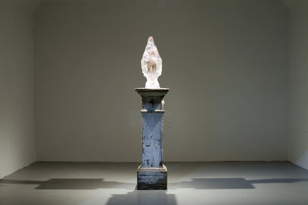 Madre (Mother), installation, 2011, resin, cotton, found object made of wood (pillar), dimensions vary.