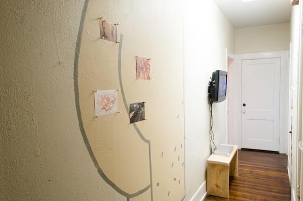 Cody Ledvina interprets Nicholas Hlobo in the hallway.
