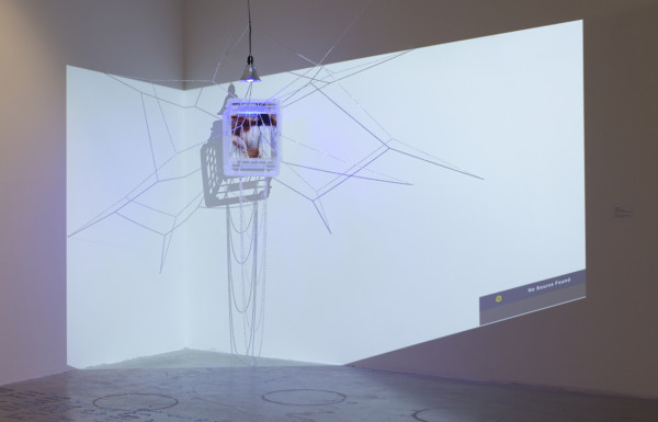 AN ANDACHTSBILDER (PRYING PERCEPTION OPEN) [version 2], 2012 variable size, photographic print, resin, plastic crate, jewelry chain, colored lights, HD projector with no input source.
