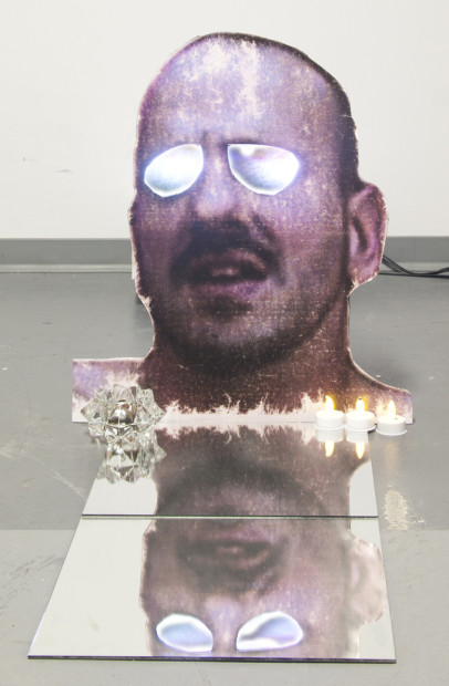 A HERMA (DEAD EYES OPENED), 2011, 42x36x36, Medium: Photographic print mounted on foamcore, video projector, DVD, LED candles, mirror, glass dish, coins