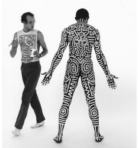 "Photo: Tseng Kwong Chi. ""Bill T. Jones & Keith Haring,"" 1983. Silver gelatin selenium-toned fiber prints, 20 x 16 inches. ©1983 Muna Tseng Dance Projects, Inc. NY. Body drawing on Bill T. Jones by Keith Haring, ©Keith Haring Foundation"