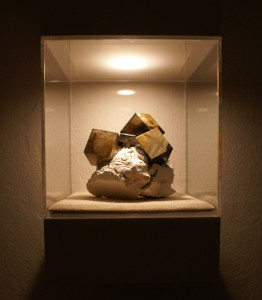 Atramentite #2 (small sculpture on right). Ink, paper, foam core, wax, plaster, wood, plexiglass. Photo courtesy of the artist.