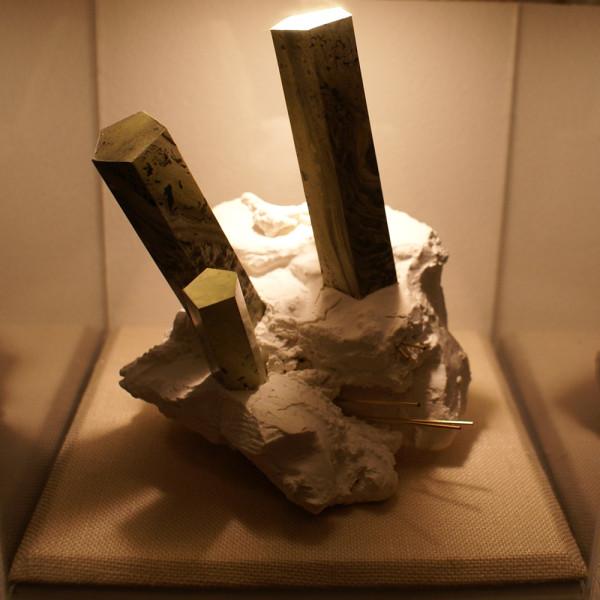 Atramentite # 3 (small sculpture middle). Ink, paper, foam core, wax, plaster, gold rod, wood, plexiglass. Photo courtesy of the artist.