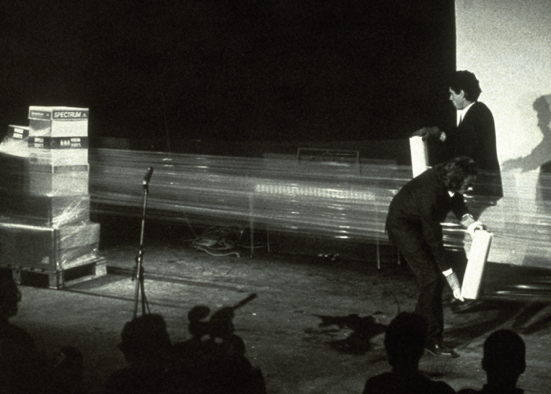 The Art Guys' Wrap Music performance at Diverse Works in 1992. This piece was recreated at the SonicWorks opening. (Photo by John A. Wilson)