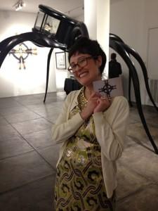 Miranda Lash in front of Chin's Cabinet of Craving, 2012. Photo: Jim Mulvihill