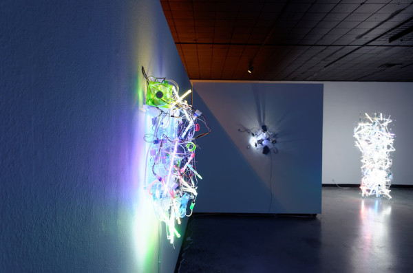 Gallery View with Hybrid Auto, flexible mirrors, gear motors, USB hub, USB LED lights, USB flex fans, laser printer alignment mirrors, Plexiglas, 27 x 29 x 12 inches, 2013. Photo courtesy of Women & Their Work.