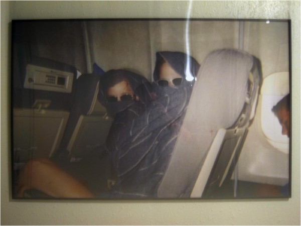 A snapshot taken on a plane right before 9/11 of Emily and her friend being goofy with an airline blanket. The large-scale photograph that hangs in her bedroom won Juror's choice at Lawndale's The Big Show in 2010