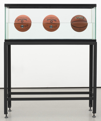 """Three Ball 50/50 Tank (Two Dr. J. Silver Series, One Wilson Supershot) Date:     1985 Medium:     Glass, painted steel, distilled water, plastic, and three basketballs Dimensions:     60 5/8 x 48 3/4 x 13 1/4"""" (154 x 123.9 x 33.6 cm) Credit Line:     Gift of Werner and Elaine Dannheisser MoMA Number:     226.1991.a-f Copyright:     © 2014 Jeff Koons"""