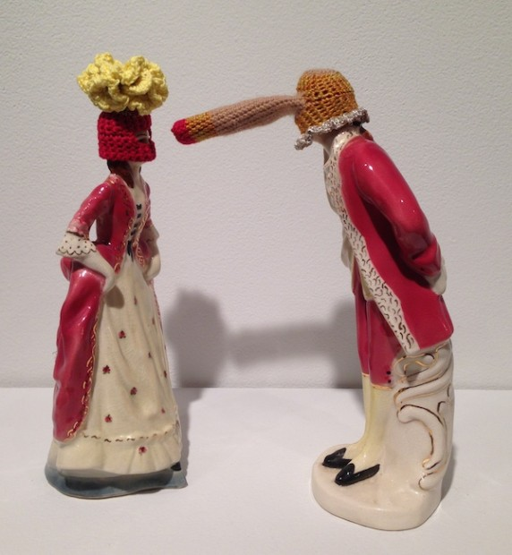 "Elaine Bradford, <em>I See You</em>, 2014. Ceramic figurines and crocheted embroidery thread, 10"" x 9"" x 4"""