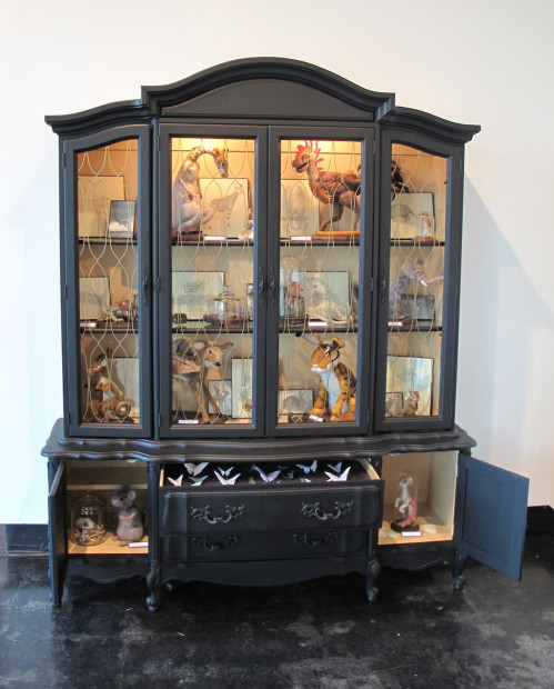 "Torie Shelton, <em>Wonder & Curiosity</em>, 2014. Wood cabinet, lithograph prints, needle felted specimens, found objects and screen printed insects, 82"" x 98"" x 21"""