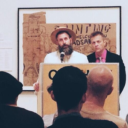 Kenneth Goldsmith (left) and Christian Bok, speaking at the CAMH, from Goldsmith's Twitter account