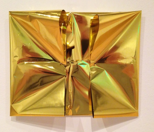 <em>Avalon</em>, 2014. Gold wrapping paper and a poem written by the artist