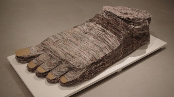Barefoot and Pregnant, 2013, cut and stacked newsprint, cardboard, glue.