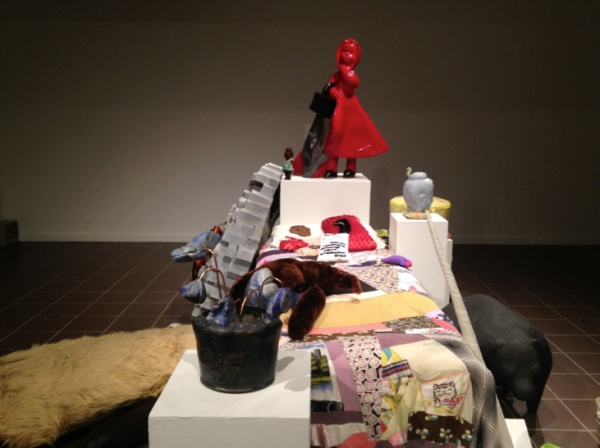 Wanderer (bed in center), 2004, fabric and objects on found quilt.