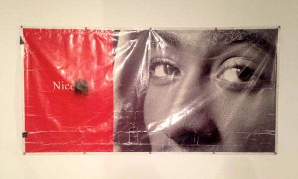 The Black Guys' response to Luc Tuyman's banner for his Menil exhibit