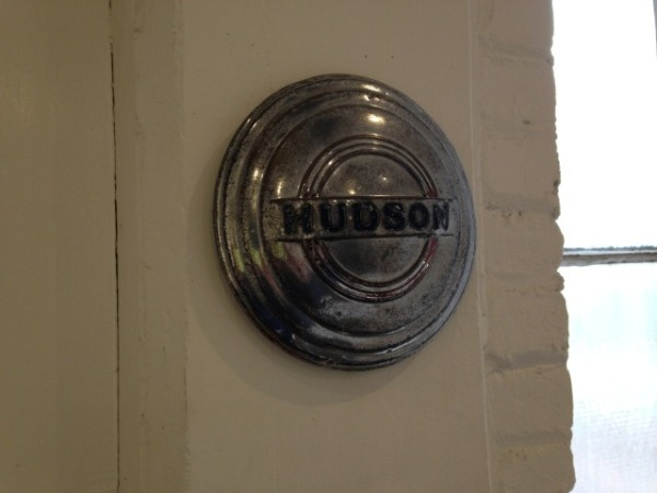 Gallery windows. Hudson hubcap as found object.