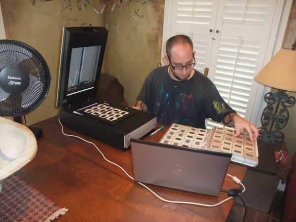 Jonathan Leach scanning slides for artist Toby Topek for the CALL Project, 2012. Photo courtesy of Patricia Hernandez and DiverseWorks.