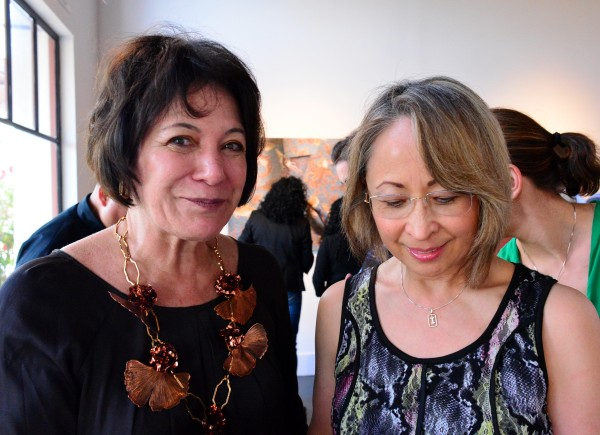"The artist Cecilia Paredes (l) at the opening of her show ""The Wandering Flight."""