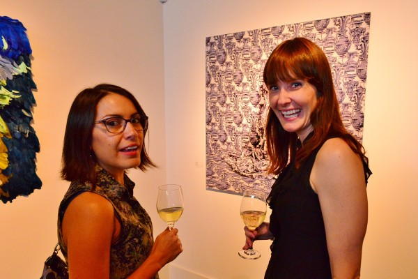 """Photographer Jenelle Esparza and Ruiz-Healy Art Assistant Director Alana Coates with a work titled """"Corinthians – 3/7"""" 2014."""