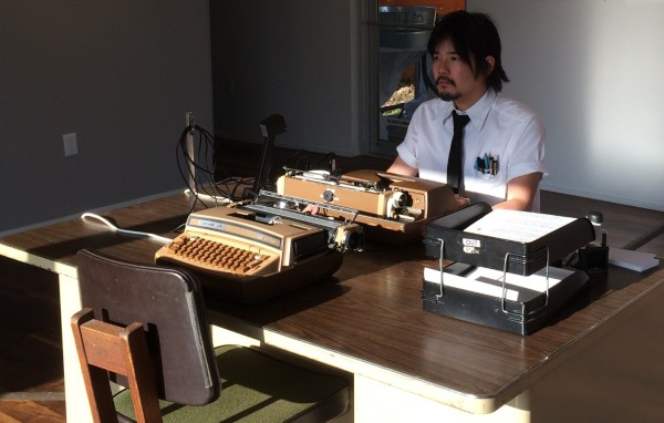 """Mat Kubo preparing for a performance of """"No Talking, Just Typing"""""""