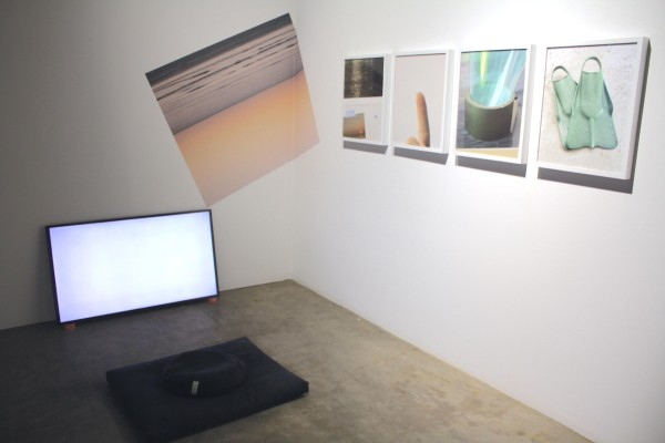 Dan Schmahl, Sunset Cycle, 2015, HD Video (looped), meditation pillow, inkjet print, sex wax. Untitled, 2014-15, Four archival pigment prints.